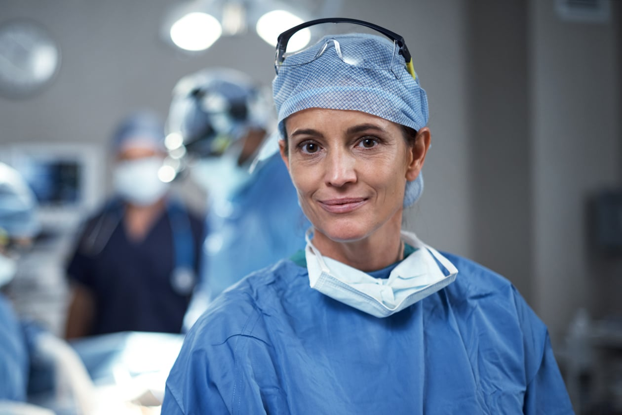 Portrait of a nurse looking happy in an operating room