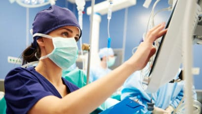 Nurse working with technology in operating room