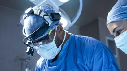 Surgeons performing a surgical procedure